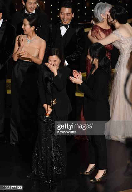 Kwak Sinae and interpreter Sharon Choi accept the Best Picture award for 'Parasite' onstage during the 92nd Annual Academy Awards at Dolby Theatre on...