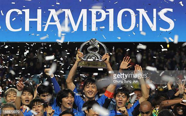 Kwak Tae-Hwi of Ulsan Hyundai and other players celebrate with the AFC Champions League Final Tropy after winning the 2012 AFC Champions League final...