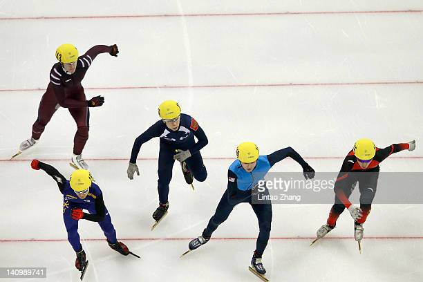 Kwak YoonGy of Korea Dequan Chen of China Jekabs Saulitis of Latvia Simon Cho of USA and Semen Elistratov of Russia compete in the Men's 1500m...