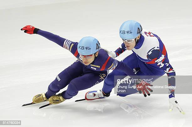 Kwak YoonGy of South Korea and Vladimir Grigorev of Russia compete in the Men 1000mHeats during the ISU World Short Track Speed Skating Championships...