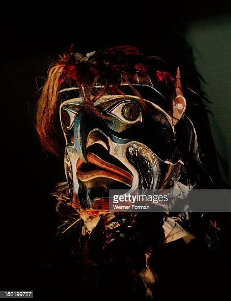 Kwakiutl hawk spirit mask from Alert Bay Eagle feathers coloured chicken feathers human hair leaves and twigs frame the face Northwest Coast of...
