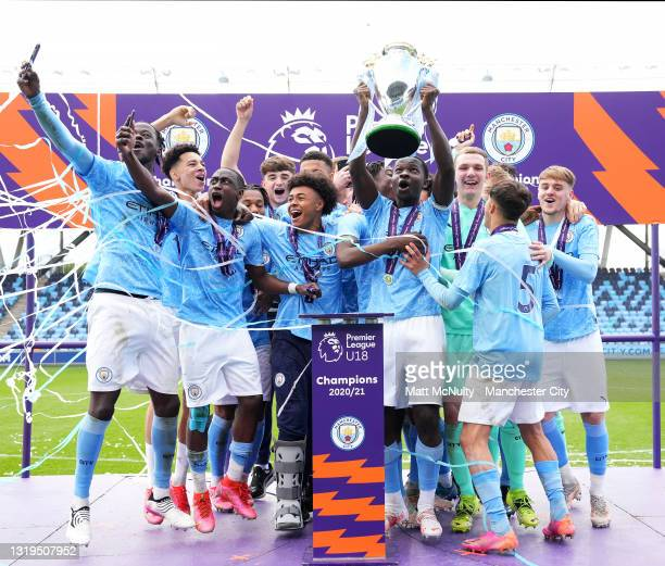 Kwaku Oduroh of Manchester City lifts the Premier League trophy with teammates during the U18 Premier League Final match between Manchester City and...