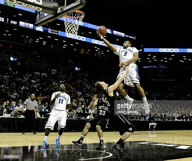 Kwamain Mitchell of the St Louis Billikens puts up a shot past Rotnei Clarke of the Butler Bulldogs in the second half during the Atlantic 10...