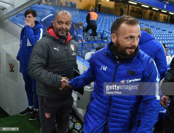 Kwame Ampadu the Manager of Arsenal U18 shakes hands with Jody Morris the Chelsea U18 Manager before the match between Chelsea U18 and Arsena U18 at...