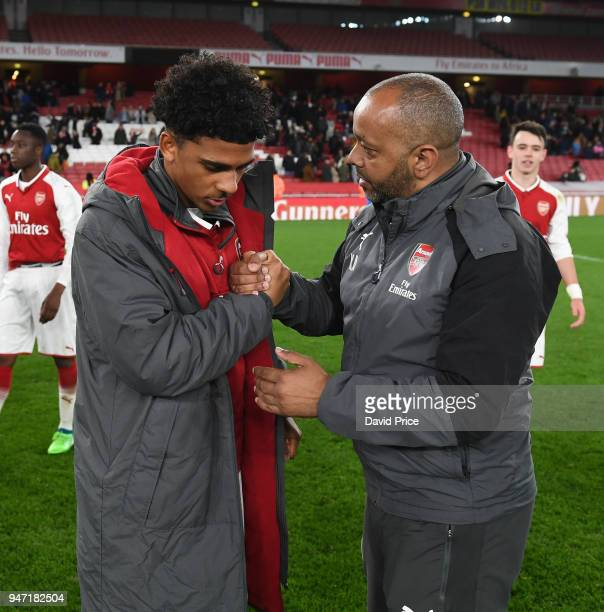 Kwame Ampadu the Manager of Arsenal U18s has a word with Xavier Amaechi after the match between Arsenal and Blackpool at Emirates Stadium on April 16...