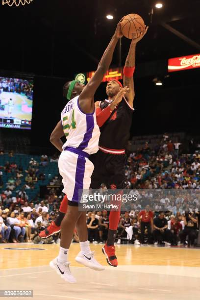 Kwame Brown of 3 Headed Monsters blocks a shot by Kenyon Martin of Trilogy during the BIG3 three on three basketball league championship game on...