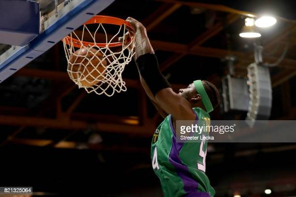 Kwame Brown of the 3 Headed Monsters dunks against 3's Company during week five of the BIG3 three on three basketball league at UIC Pavilion on July...