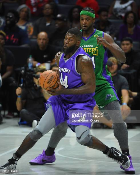 Kwame Brown of the 3 Headed Monsters guards Ivan Johnson of Ghost Ballers during the BIG3 game at Staples Center on August 13 2017 in Los Angeles...