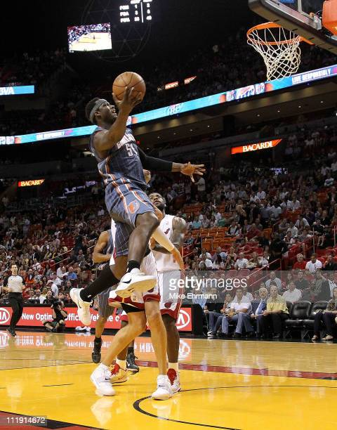 Kwame Brown of the Charlotte Bobcats drives to the lane during a game against the Miami Heat at American Airlines Arena on April 8 2011 in Miami...