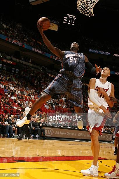 Kwame Brown of the Charlotte Bobcats goes to the basket against Zydrunas Ilgauskas of the Miami Heat during the NBA game on April 8 2011 at American...