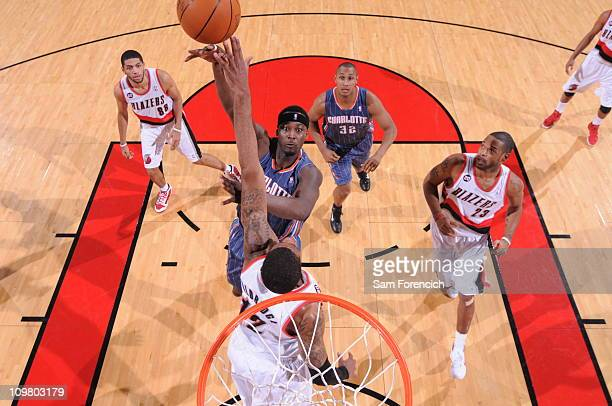 Kwame Brown of the Charlotte Bobcats goes up for a shot against LaMarcus Aldridge of the Portland Trail Blazers during a game on March 5 2011 at the...