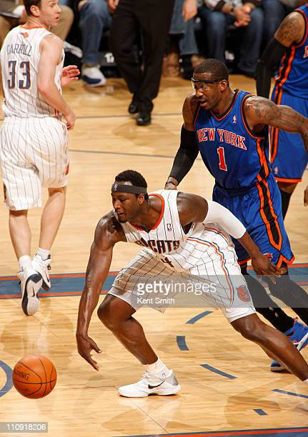 Kwame Brown of the Charlotte Bobcats hustles for a loose ball against Amar'e Stoudemire the New York Knicks on March 26 2011 at Time Warner Cable...