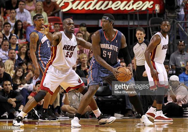 Kwame Brown of the Charlotte Bobcats posts up Joel Anthony of the Miami Heat during a game at American Airlines Arena on April 8 2011 in Miami...