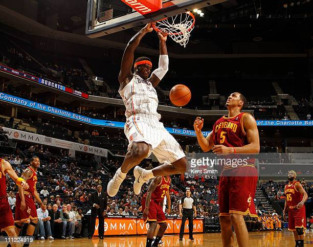 Kwame Brown of the Charlotte Bobcats puts down a dunk against the Cleveland Cavaliers on March 30 2011 at Time Warner Cable Arena in Charlotte North...