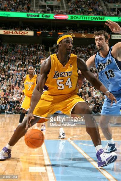 Kwame Brown of the Los Angeles Lakers drives the lane against Mehmet Okur of the Utah Jazz on November 24, 2006 at the Energy Solutions Arena in Salt...