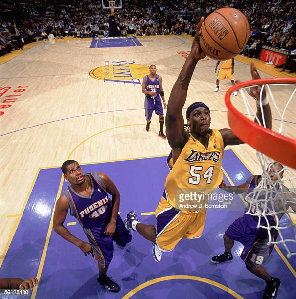 Kwame Brown of the Los Angeles Lakers reaches for the basket against Kurt Thomas of the Phoenix Suns at Staples Center on November 3 2005 in Los...