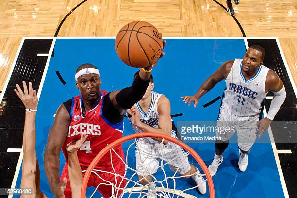 Kwame Brown of the Philadelphia 76ers shoots against the Orlando Magic during a preseason game on October 11 2012 at Amway Center in Orlando Florida...