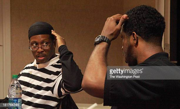 Kwame Dew and Jamal Reed compare where their brain injuries are which they both incurred from gunshots during a meeting at the Urban Reentry Group at...