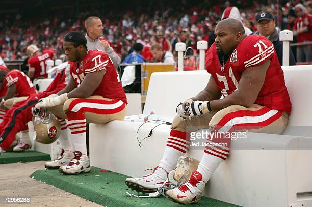 Kwame Harris and Larry Allen of the San Francisco 49ers look on from the bench during the game against the Arizona Cardinals at Monster Park on...