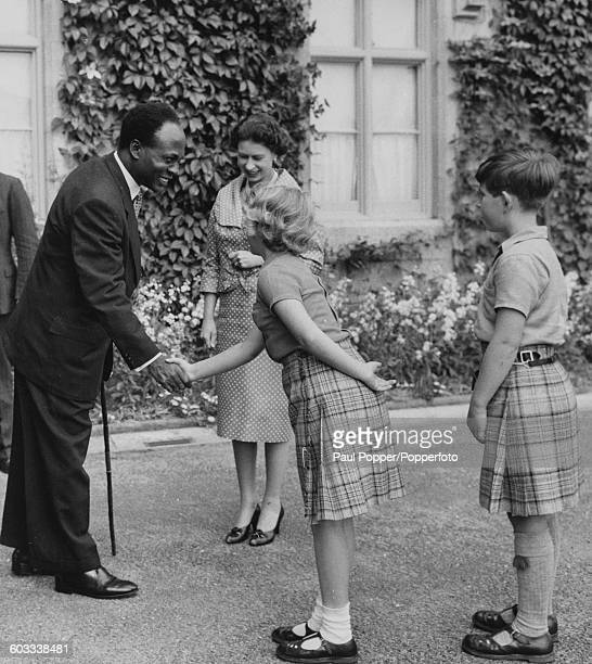 Kwame Nkrumah Premier of Ghana shakes hands with Princess Anne and Prince Charles as their mother Queen Elizabeth II looks on at Balmoral Scotland...