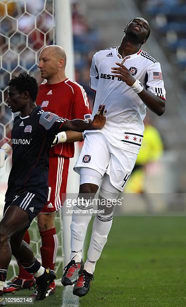 Kwame WatsonSiriboe of the Chicago Fire reacts after missing a chance for a goal as Emmanuel Osei and Matt Reis of the New England Revolution watch...