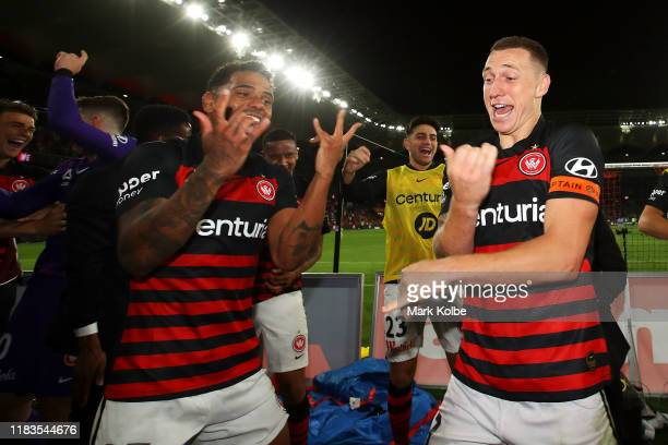 Kwame Yeboah and Mitchell Duke of the Wanderers and their team mates dance as they celebrate with the crowd after victory during the round three...