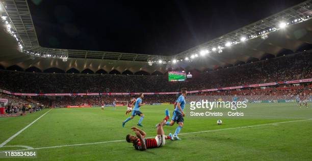 Kwame Yeboah of the Wanderers is tackled by Sydney's Paulo Retre during the round three ALeague match between the Western Sydney Wanderers and Sydney...