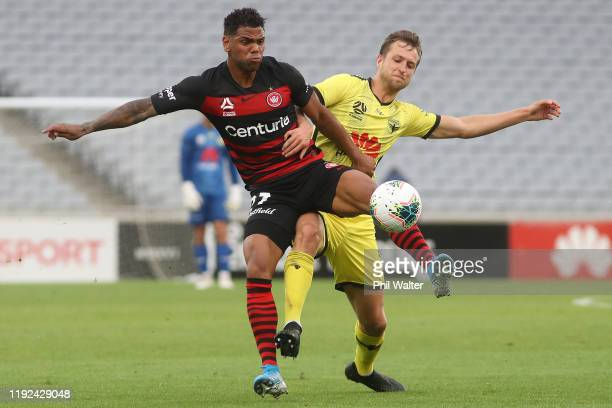 Kwame Yeboah of the Western Sydney Wanderers and Natty Steinmann of the Wellington Phoenix contest the ball during the round nine A-League match...