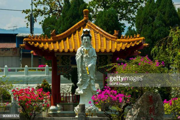 TEMPLE IPOH PERAK MALAYSIA Kwan Im the goddess of mercy statue is seen at front of the temple Perak Tong cave temple was discovered in 1926 by Chong...