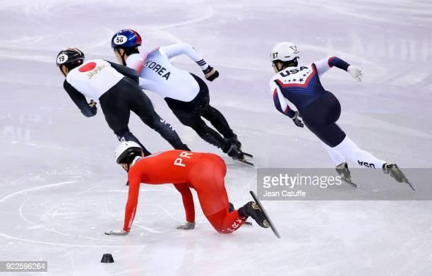 Kwang Bom Jong of North Korea falls as Keita Watanabe of Japan Daeheon Hwang of South Korea and Thomas Insuk Hong of USA compete during Short Track...