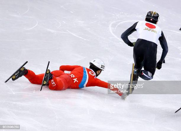 Kwang Bom Jong of North Korea falls next to Keita Watanabe of Japan during Short Track Speed Skating Men's 500m series on day eleven of the...
