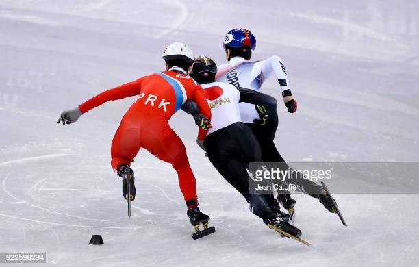 Kwang Bom Jong of North Korea Keita Watanabe of Japan and Daeheon Hwang of South Korea during Short Track Speed Skating Men's 500m series on day...