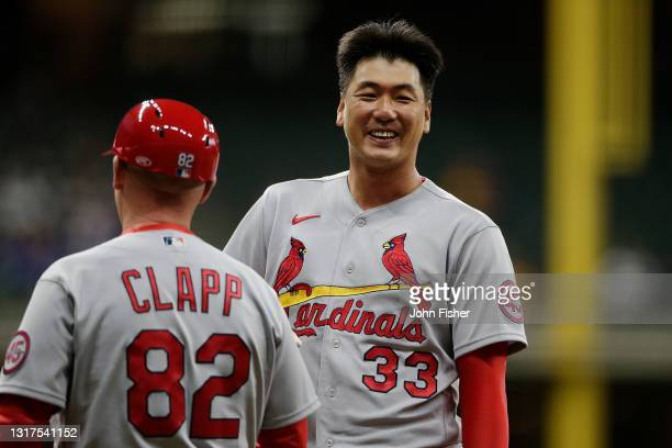 Kwang Hyun Kim of the St. Louis Cardinals smiles after reaching first base on an error in the sixth inning against the Milwaukee Brewers at American...