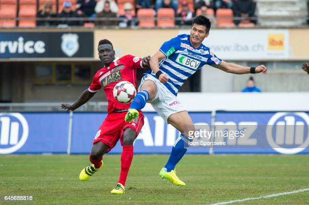 Kwang Ryong Pak vies with Joaquim Adao during the Swiss Super League match between FC LausanneSport and FC Sion at Stade Olympique de la Pontaise in...