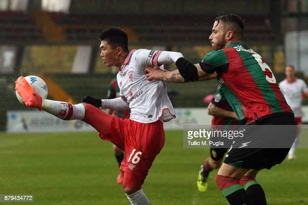Kwang Song Han of Perugia controls the ball as Andrea Signorini of Ternana tackles during the Serie A match between Ternana Calcio and AC Perugia at...