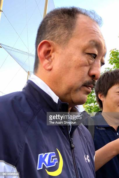 Kwansei Gakuin University head coach Hideaki Toriuchi speaks to media reporters after Nihon University American football player Taisuke Miyagawa's...