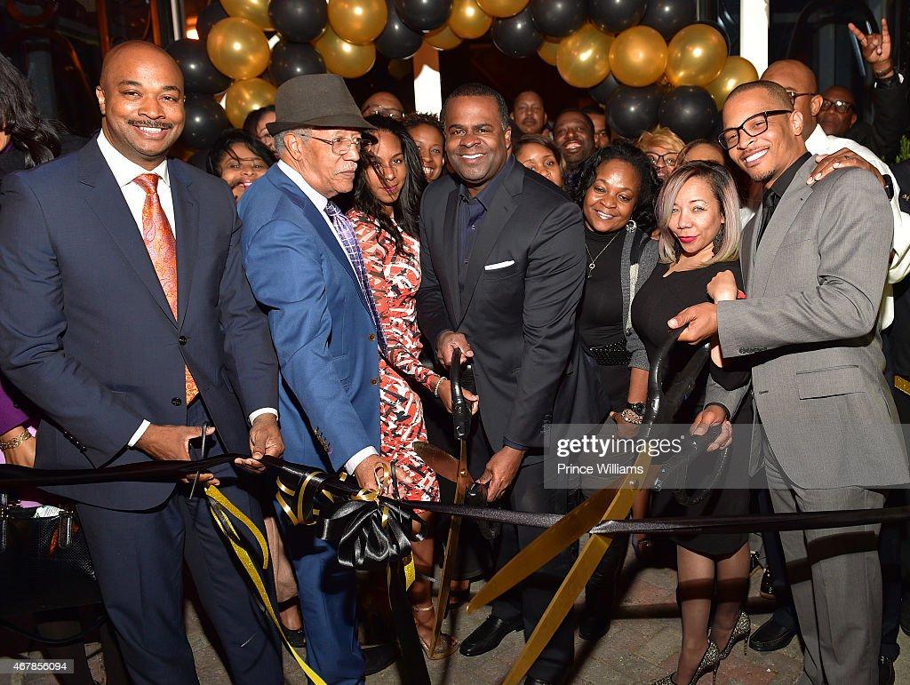 Kwanza Hall, Kasim Reed, Tameka 'Tiny' Harris, and Clifford 'T.I. Harris attend 925 Scales ribbon cutting at 925 Scales on March 27, 2015 in Atlanta, Georgia.