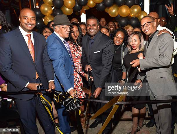 Kwanza Hall, Kasim Reed, Tameka 'Tiny' Harris, and Clifford 'T.I. Harris attend 925 Scales ribbon cutting at 925 Scales on March 27, 2015 in Atlanta,...