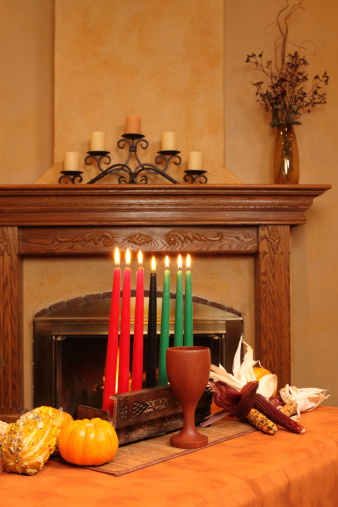 Kwanzaa Candles By Fireplace All Lit Vertical 183371221