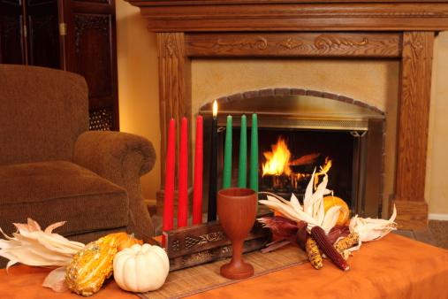 Kwanzaa Candles By Fireplace Horizontal 183339612