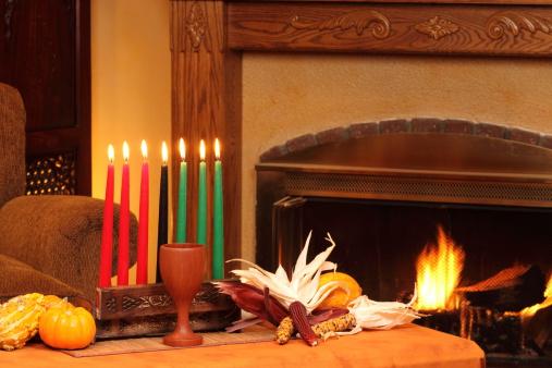 Kwanzaa Candles By Fireplace Left Horizontal 183328109