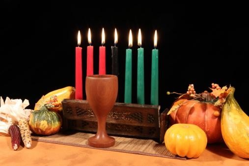 Kwanzaa Display on Black All Candles Lit 183419549