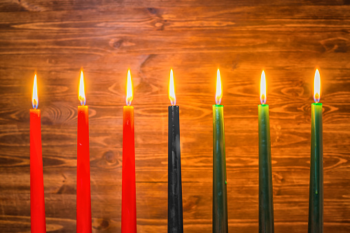 Kwanzaa festival concept with seven candles red, black and green 628039376