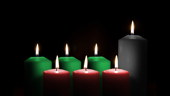 Kwanzaa for African-American cultural holiday celebration with candle light of seven candle sticks in black, green, red symbolising 7 principles of African Heritage (Nguzo Saba) 1185435869