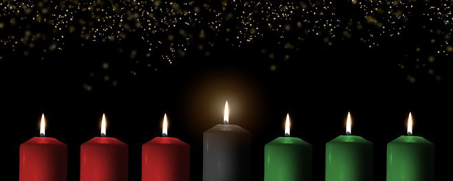 Kwanzaa for African-American cultural holiday celebration with candle light of seven candle sticks in black, green, red symbolising 7 principles of African Heritage (Nguzo Saba) 1185761174
