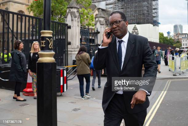 Kwasi Kwarteng Secretary of State for Business Energy and Industrial Strategy speaks on his mobile phone outisde the Houses of Parliament in London...
