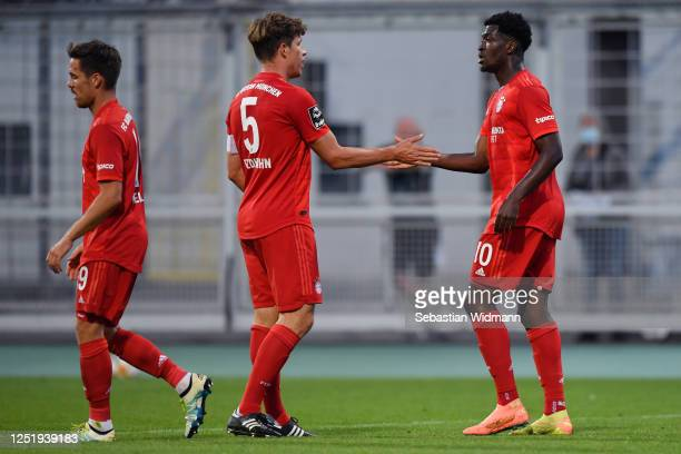 Kwasi Okyere Wriedt of Bayern Muenchen II celebrates his team's first goal with teammate Nicolas Feldhahn during the 3. Liga match between Bayern...