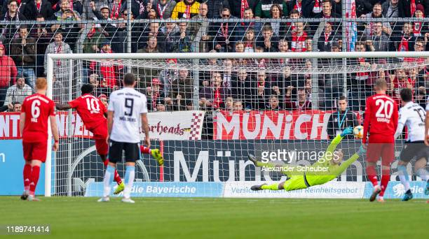 Kwasi Okyere Wriedt of Bayern Muenchen II scores the first goal for his team against Marco Hiller of 1860 Muenchen during the 3. Liga match between...