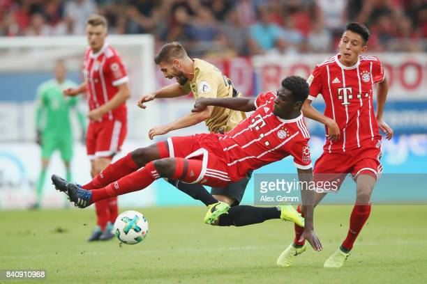 Kwasi Wriedt of Muenchen is challenged by Dennis Schulte of Offenbach during a friendly match between Kickers Offenbach and FC Bayern Muenchen at...