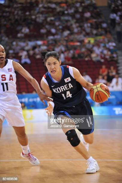 Kwe Ryong Kim of the U.S. Women's Senior National Team drives against Korea during their quaterfinal women's basketball game on Day 11 of the Beijing...